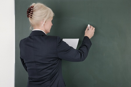 Photo Of A Business Woman Drawing Up Business Plan During Business Presentation Or Meeting In A Strategy And Tactical Concept