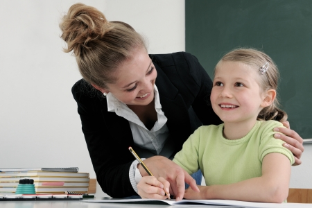 internship: Teacher and Student In A Classroom At School