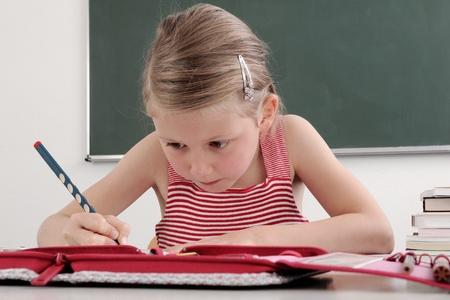 a schoolgirl in a classroom  Stock Photo