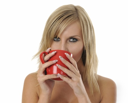 Portrait of happy blond woman with coffee on white background