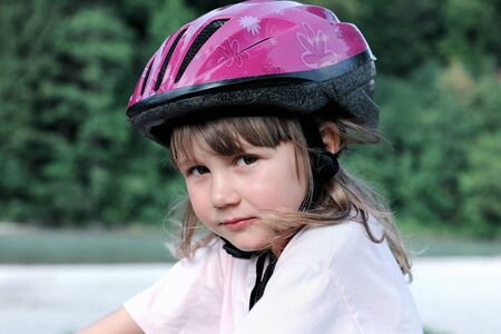 Young blonde girl in a bicycle helmet  Stock Photo