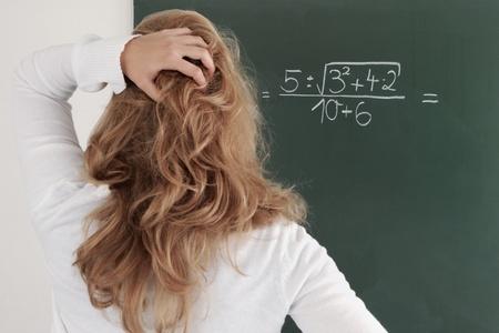 Student being examinated from math  Standard-Bild