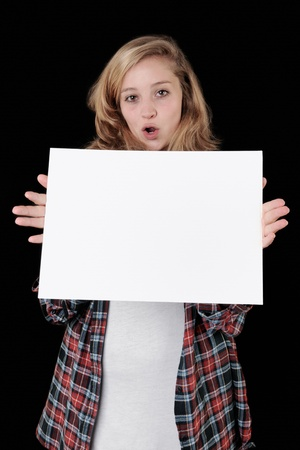 Full length portrait of a happy young casual woman holding a blank signboard and pointing