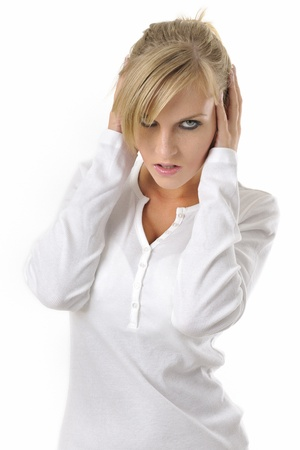 Young unhappy woman with severe headache holding forehead in pain  Stock Photo
