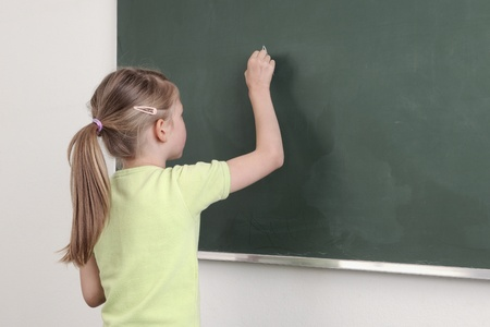Schoolgirlat the chalkboard Stock Photo