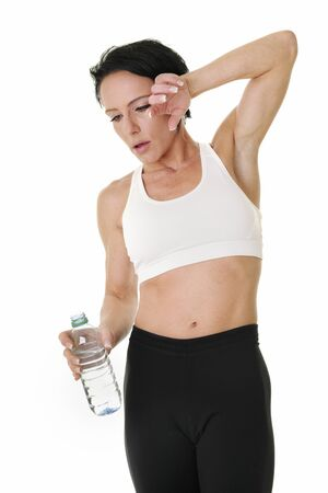 Attractive Girl drinking after exercise