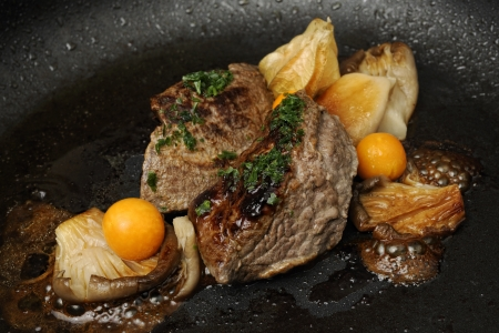 Roasted fillet of venison on oyster mushrooms with physalis Stock Photo
