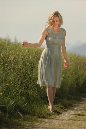 Woman walking in a meadow
