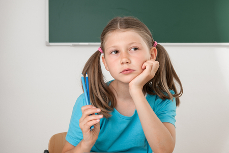 Female pupil listening to lessons