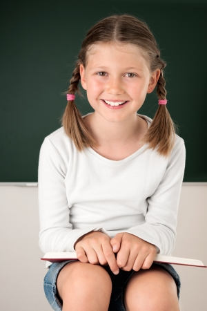 Female pupil in front of the black board
