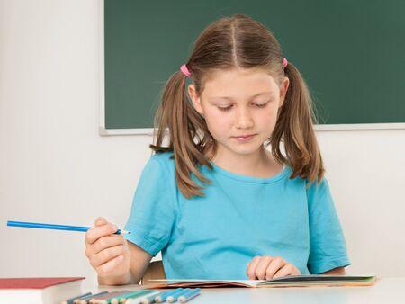 Female pupil having lessons at school