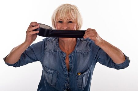 woman with tape over his mouth Stock Photo - 10543335