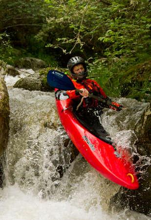 kayaker: kayaks going down the river Urbion in La Rioja