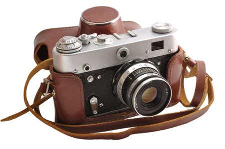 Geïsoleerde gebruikte ouderwetse film foto-camera in lederen tas Stockfoto