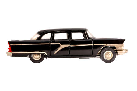 front side: Black retro limousine old scale model isolated on white