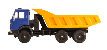 dump truck: Toy dump truck collection scale model side view isolated on white background
