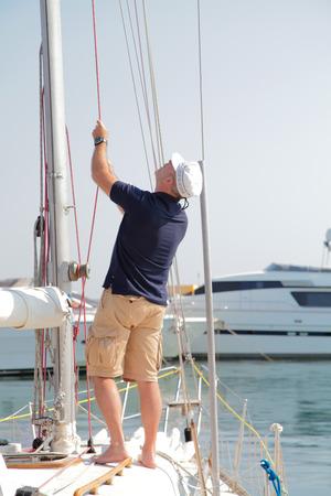 berth: professional yahstmen standing on a yacht, at berth