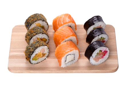japanese cookery: sushi set in a kitchen board, isolated on white Stock Photo
