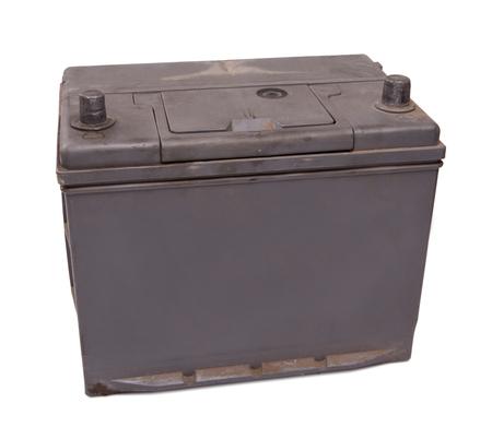 12v: bater�a vieja y sucia coche. detalle en blanco