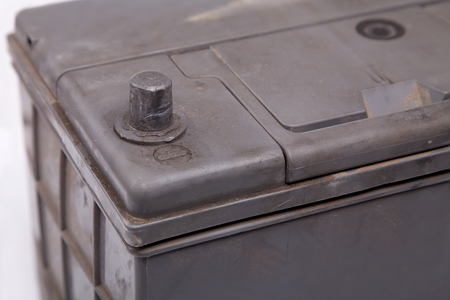 electrolyte: old and dirty car battery. minus terminal closeup