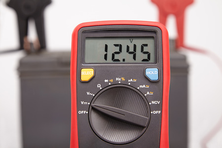 electrolyte: car battery voltage measurement. the value of the tester closeup