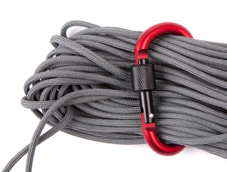 carabiner: coil of rope with a red carabiner
