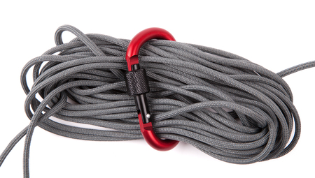abseil: coil of rope with a red carabiner