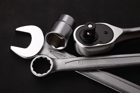 ratchet: wrenches and ratchet on a dark textured background Stock Photo