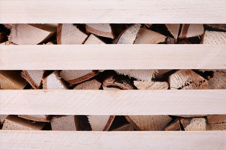 storage box: firewood in the box, storage of solid fuel, close-up Stock Photo