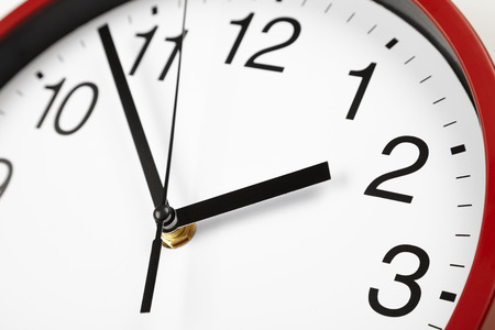 midday: black and white clock face, midday on the clock, time close-up