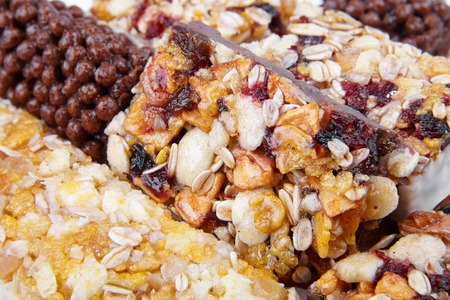 cereal bar: Sweet cereal bar with different berries and fruits. Diet sweets, healthy food