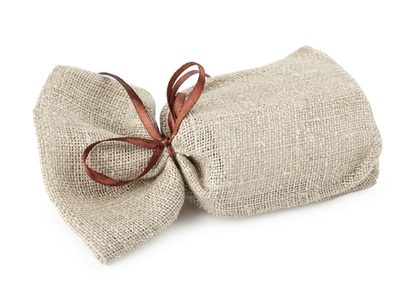 cloth bag with a gift, a pleasant surprise isolated on white