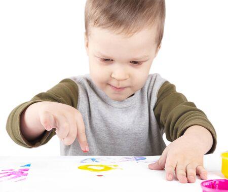 fingerprints: small child draws paints, watercolor fingerprints Stock Photo