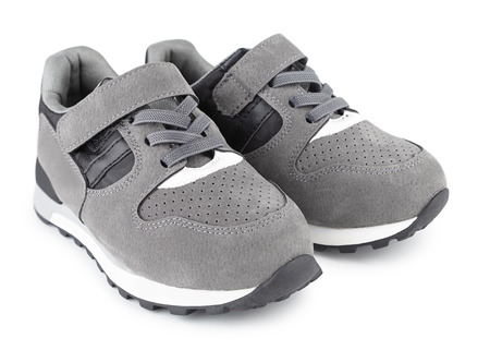 children's sports sneakers of gray color, boyish casual shoes isolated on white Zdjęcie Seryjne