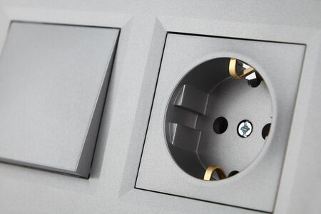 European standard electrical switch and socket, set for household electrical wiring close-up