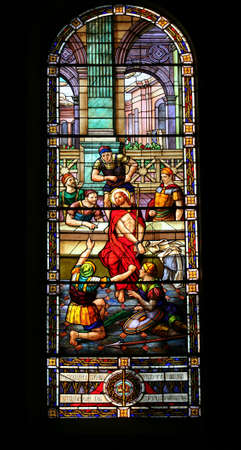 stained glass window with a scene of the soldiers mocking jesus