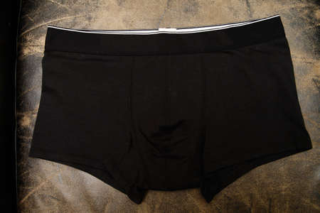 Black underpants for men on black background, isolated Stock Photo