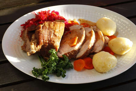 roast meat with dumplings, carrots and red cabbage Stock Photo