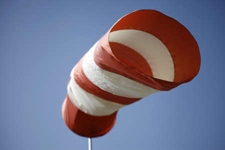 red white windhose blowing in the wind Stock Photo