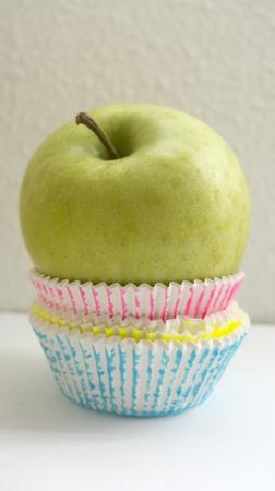 than: An apple better than a cupcake diet Stock Photo