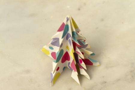 Handmade paper Christmas fir on neutral background