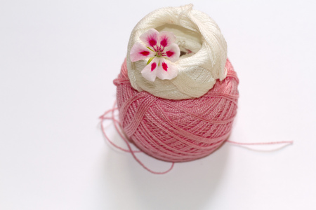 geranium color: A two-tone geranium flower of pink on embroidery threads Stock Photo