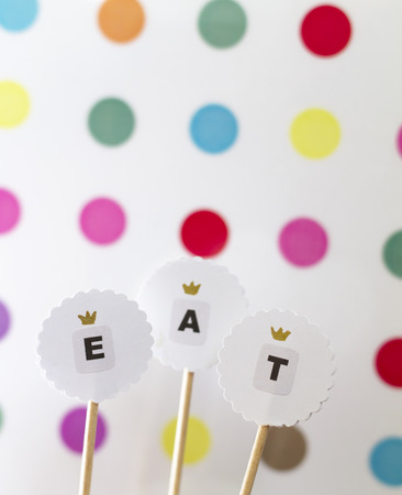 Toppers for cake decoration on polka dot backstage Stock Photo