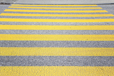 cross walk: Yellow cross walk on a Swiss street Stock Photo