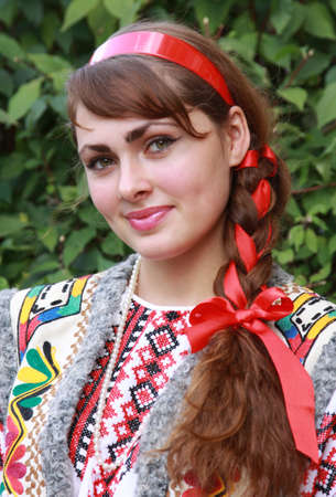 The girl is dressed in a national Ukrainian suit