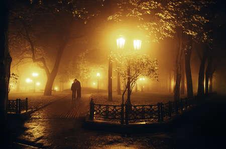dark street: Beautiful soft light of an evening city in a fog