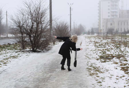 slipped: woman slipped on the snowy streets