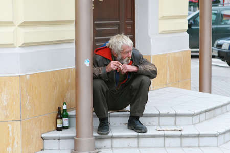 Kiev,Ukraine on June, 3rd 2006. The homeless sits in the central part of a city.
