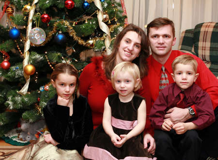 the families at the Christmas tree at home photo