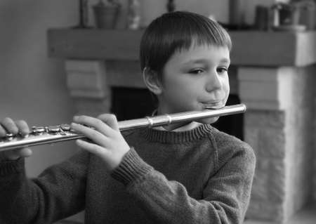 flutes: boy playing the flute